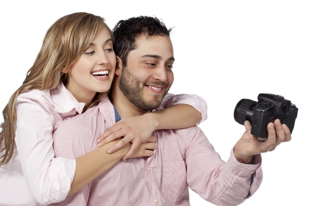 Close up image of happy couple taking picture against white background Stock Photo - 17050325