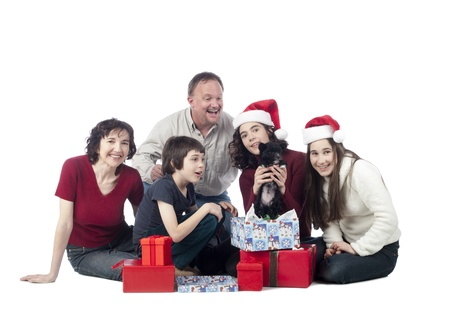 Image of happy family with gift sitting on the floor against white background Stock Photo - 16252405