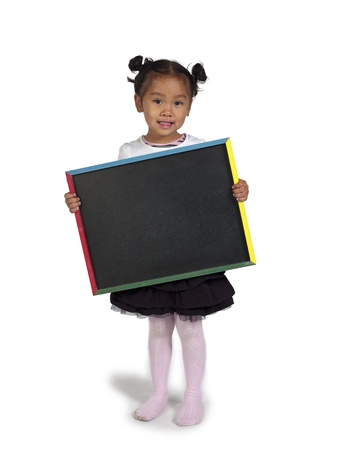 slateboard: Happy little Asian girl holding chalkboard against white background,