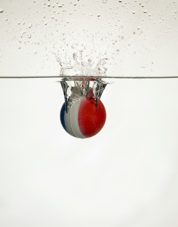 submerging: Ball dropped into the water creating splashes
