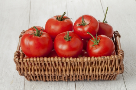 lycopene: Image of a basket of fresh tomatoes on wooden table