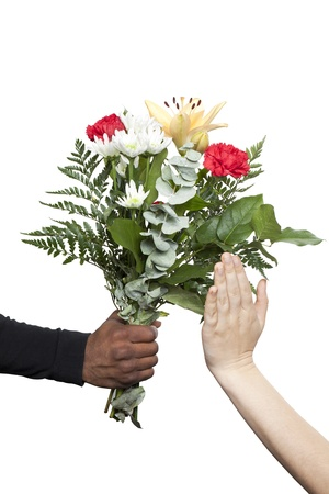 Female hand refusing the flowers that a black hand is giving
