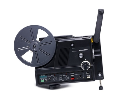 filmmaker: Old-fashioned film projector isolated in a white background