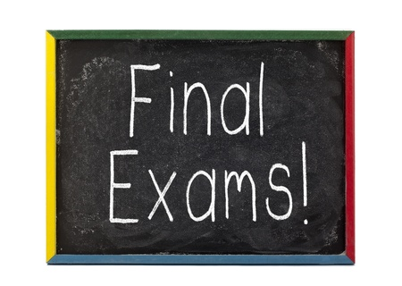 Final exams written on small students slate board Stock Photo - 16211284