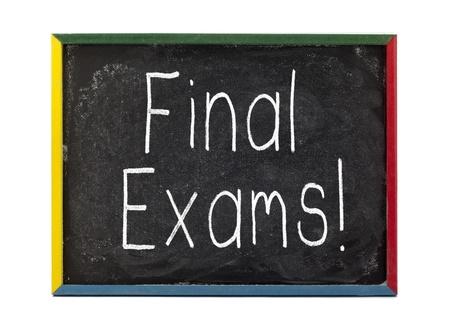 slateboard: Final exams written on small students slate board  Stock Photo