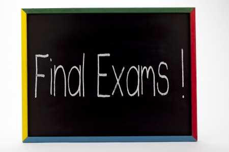 Final exams written on small students slate board  Stock Photo - 16210714