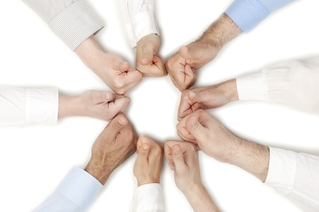 combined effort: Group of human fists forming a circle shape isolated in a white background