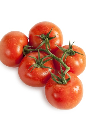 Five tomatoes arranged on a white surface