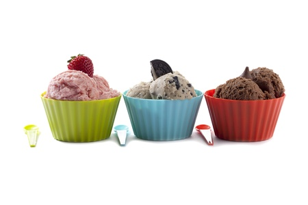plastic scoop: Three different flavor ice cream with toppings arranged horizontally on the white background Stock Photo