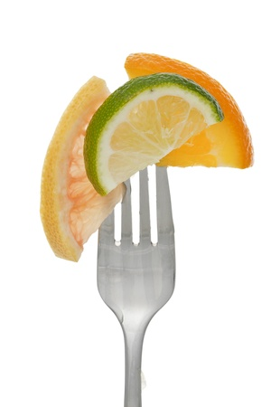 tine: Citrus slices on a fork Stock Photo