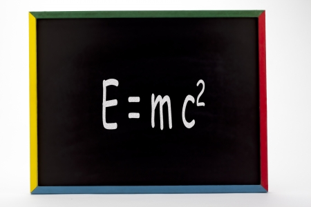 slateboard: Formula written on slate board and displayed on white background  Stock Photo