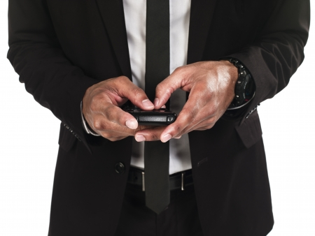 Front view mid section of business man text messaging against white background, Model  Kareem Duhaney Stock Photo - 16211448