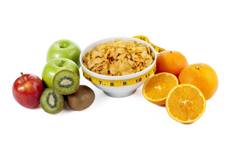 Fruits and corn flakes bowl on a close up image isolated on Stock Photo - 16211583
