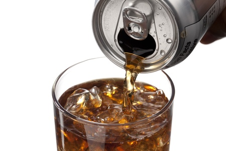 incan: An image of in-can cola moved into ice cold glass isolated on