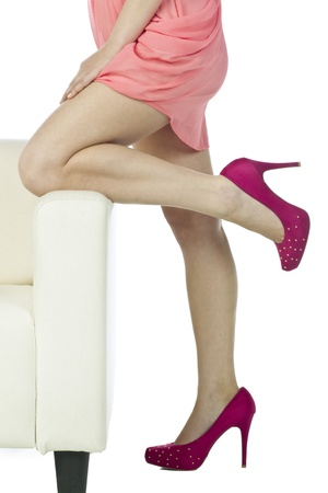Waist-down image of a gorgeous woman showing her legs and high heeled shoes photo