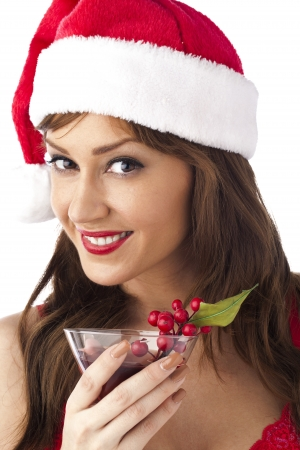 Portrait of gorgeous woman wearing santa hut with red wine isolated on white background Stock Photo - 16225769