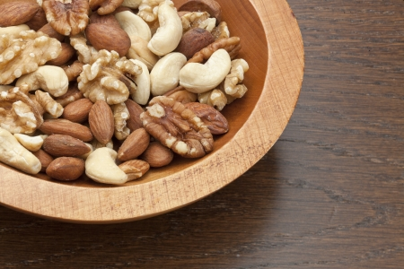 pygmy nuts: Gourmet Assorted Nuts on a wooden bowl