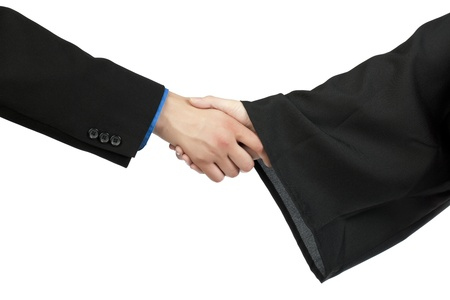 Close-up image of a graduation handshake isolated on a white surface