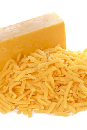 Grated bar of cheddar cheese isolated in a white background Stock Photo - 16226176