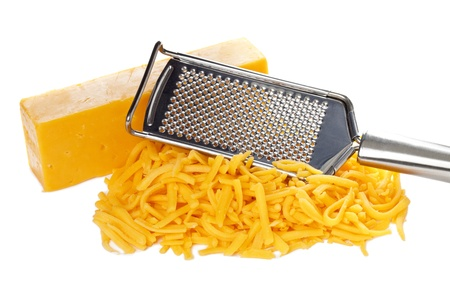Grated bar of cheddar cheese and metal cheese grater Stock Photo - 16226232