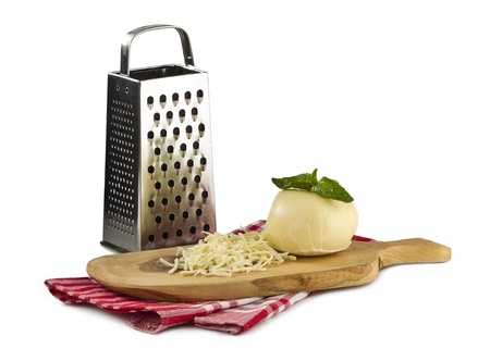 Image of Grated cheese on wooden board photo