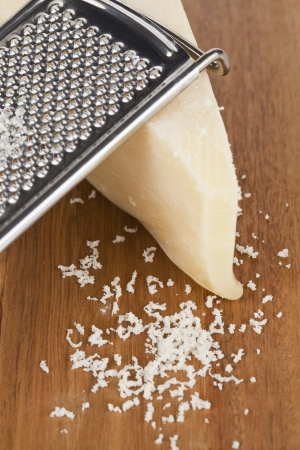 Close up image of grated feta cheese on a wooden board Reklamní fotografie