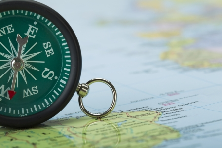 Cropped image of a green vintage compass on the top of a map Stock Photo - 16226230