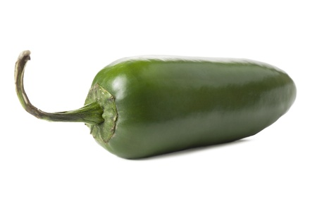 pimiento: Close-up image of green jalapeno pepper lying on a white surface