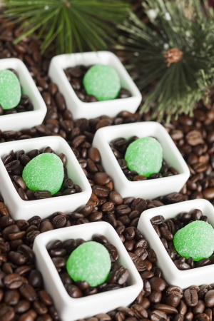 coffee jelly: Green jelly candies with coffee beans on a dish Stock Photo