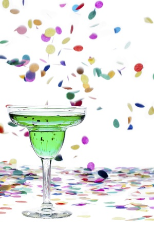 Close-up shot of green alcohol and confetti against white background  Stock Photo - 16225866