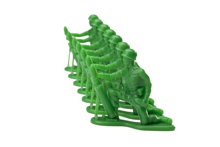 green plastic soldiers: Image of a green military toy soldiers kneeling on a white background Stock Photo