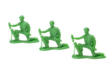 green plastic soldiers: Three green soldiers over the white background Stock Photo