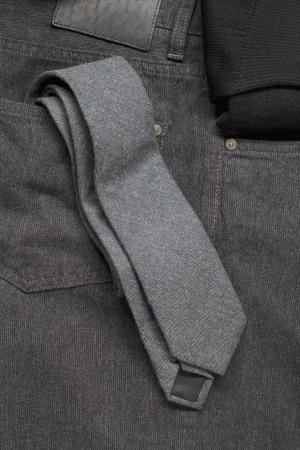 Image of grey necktie in jeans pocket Stock Photo - 16226035