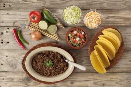 Ground beef tacos, preparation ingredients set in a wooden table
