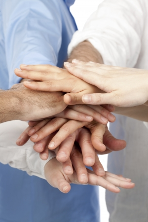 Close up image of group of business people overlapping hands Stock Photo - 16226261