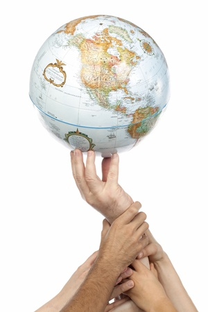Image of group of different hands with globe against white background photo