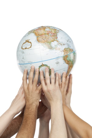 cohesion: Diverse group of hands lifting a globe isolated in a white background Stock Photo