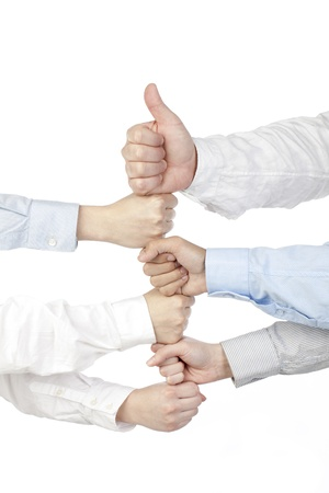 Close-up image of a group of hands with fist bumping over the white background