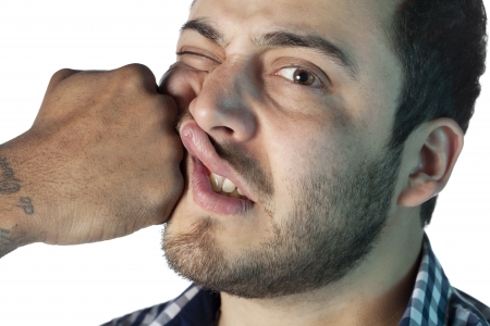 Close up image of guy face receiving a punch against white background photo