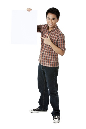 A guy smiling holding a white board against white background photo