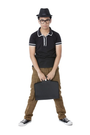 pinoy: Portrait of guy standing while holding a black bag against white background