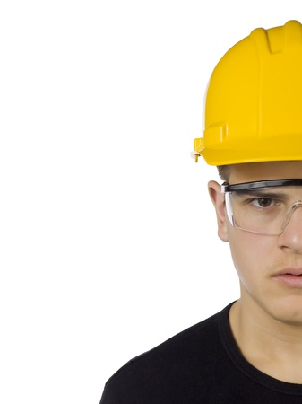 20 23 years: Close-up half face of a carpenter wearing yellow hard hat