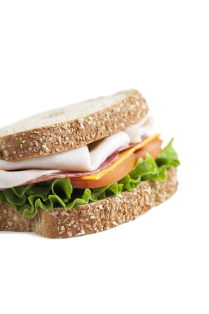 multi grain sandwich: Whole wheat sliced bread with ham and vegetables