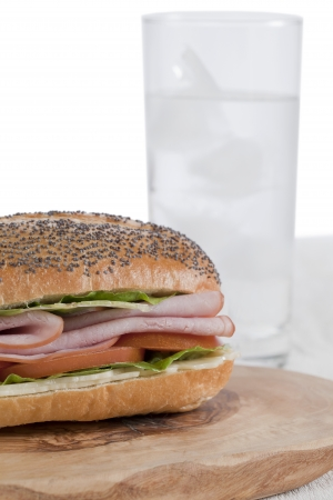 Image of ham sandwich with glass of water