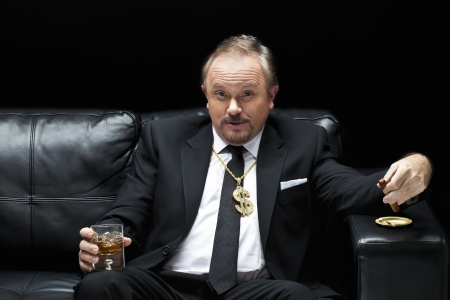 couch: Handsome mafia boss drinking and smoking while sitting on a couch, Model  Dan Sanderson