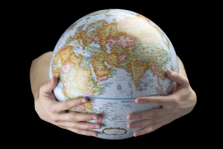 Human hand carrying a globe against the dark background Stock Photo - 16226239