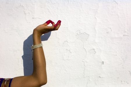 A traditional hand gesture against a wall in Dheboor, India. Stock Photo - 16225927