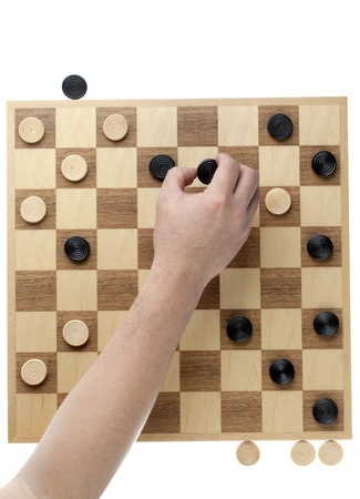 checker: Image of hand moving the checker piece against white background