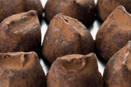 chocolate truffle: Close-up shot to the bunch of chocolate truffle on a wooden table Stock Photo