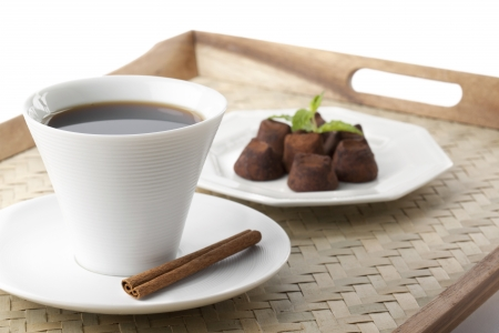 Coffee with wafer sticks and cocoa chocolate on the side for breakfast photo